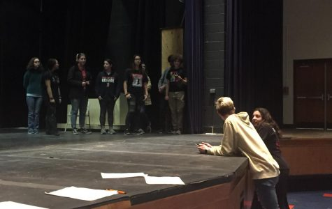 The cast and crew of Newsies prepares the stage before rehearsal starts.