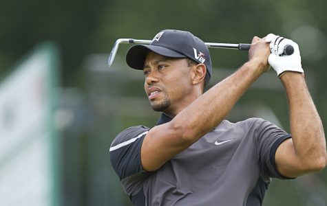 Tiger Woods tees off, as one of the four participants of
