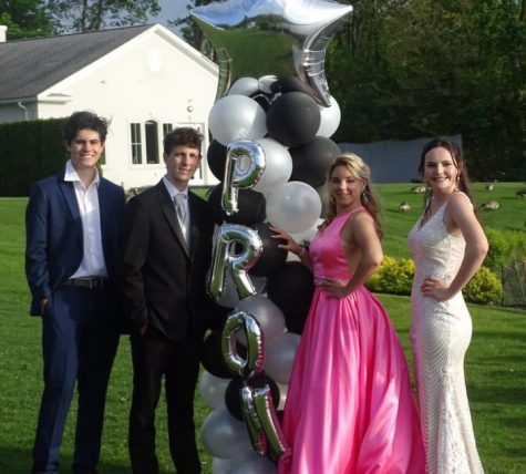 Students pose for their at-home 2020 senior prom.