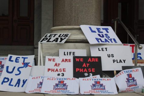 "The DHS football team pleads to the CIAC to ""let us play"" through creative signs at the Sept. 9 protest."