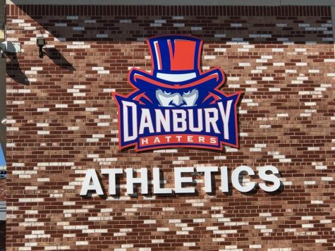 DHS unveils a new sign for  its athletes on the side of the school in time for the fall season.