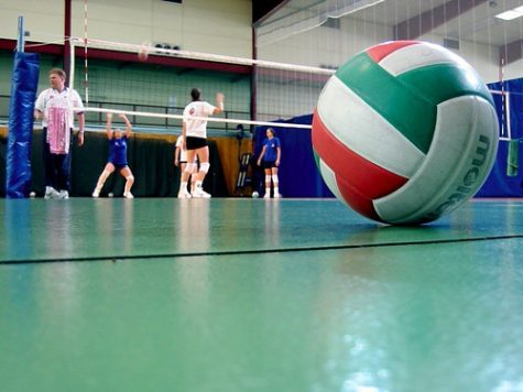 volleyball being played in a gym